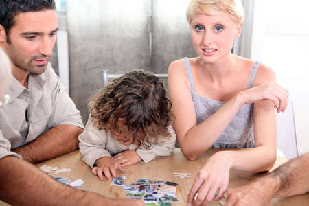 A family making a jigsaw puzzle. photo