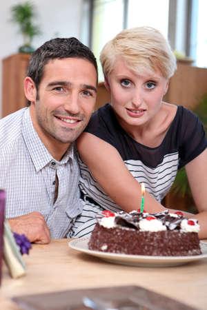 Couple with birthday cake photo
