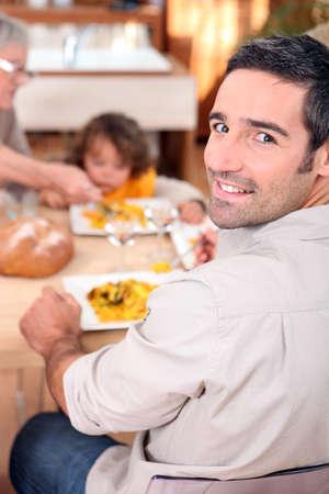 thanks giving: Family gathered around kitchen table Stock Photo