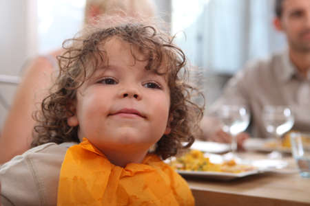little table: cute toddler having dinner with parents