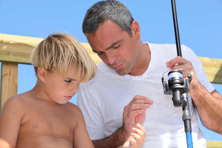 accomplices: father and son fishing Stock Photo