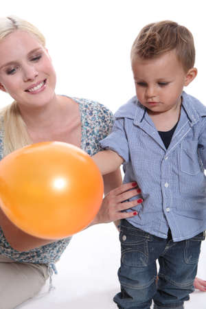 foster parenting: Woman and child with a balloon