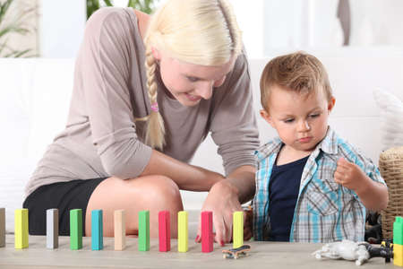 a mother playing with her 3-4 years old son Stock Photo - 14213394