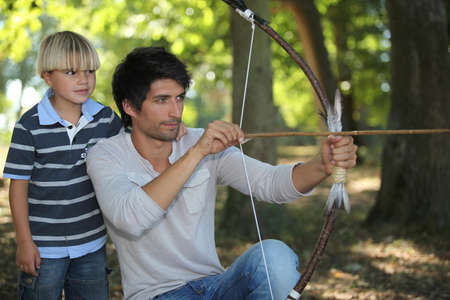archery: young man with archer and kid