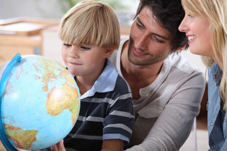 terrestrial: Little boy learning about the world with the help of his parents