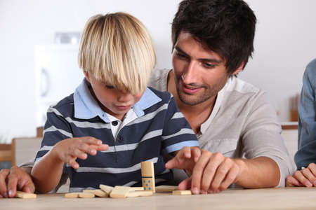 encourage: Father and son playing domino