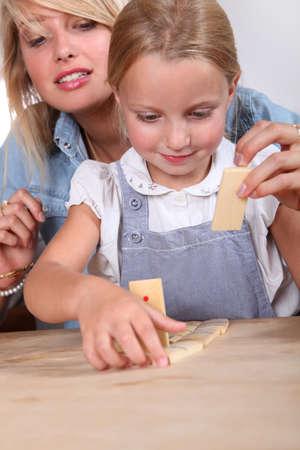 dominoes: Child playing dominoes Stock Photo