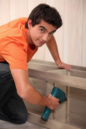 woodworker: Young man making furniture Stock Photo