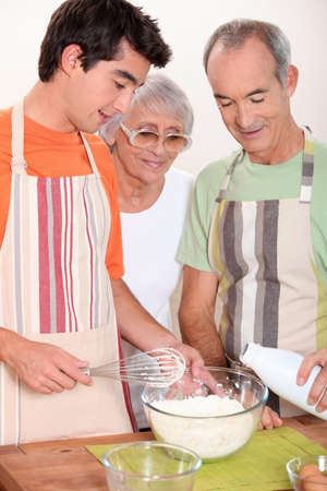 young add: Grandparents and grandson in the kitchen