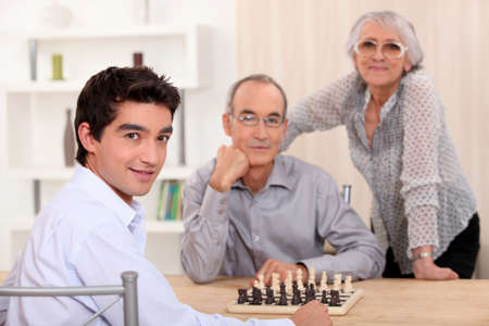 Family playing chess together photo