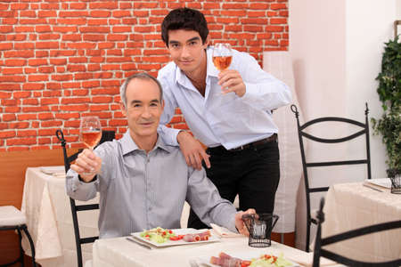 Father and son having dinner together photo