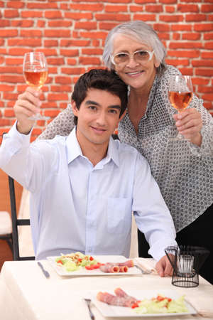 70 year old man: Man and woman raising their glasses Stock Photo