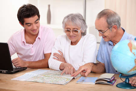 Family looking at a map Stock Photo - 14214193