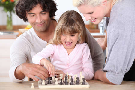 exhilarated: Father and daughter playing chess