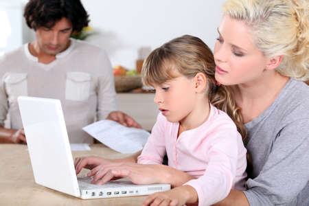 Mother with girl and computer Stock Photo - 14214608