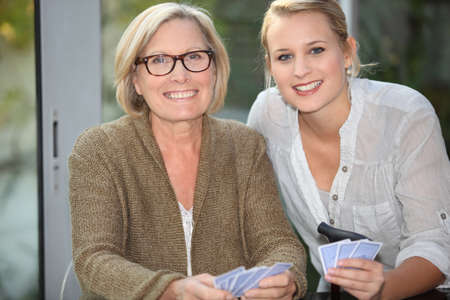 grandmother and granddaughter playing cards photo
