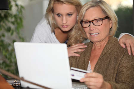 Senior woman and young girl in front of a laptop Stock Photo - 14213806
