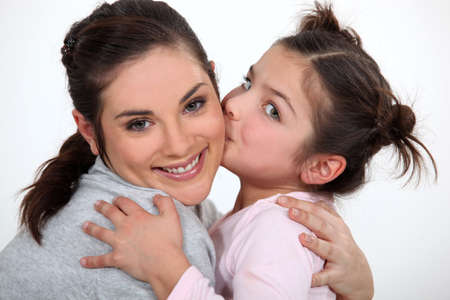 happy old age: little girl kissing her mother