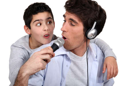 father and son listening music and singing photo