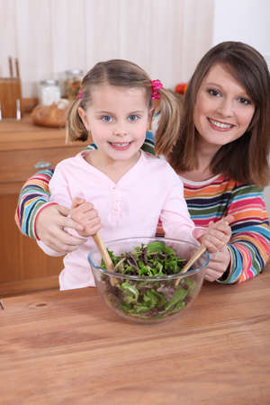 Mom and daughter cooking Stock Photo - 14213235