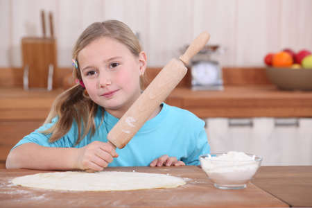 Little girl with rolling pin photo