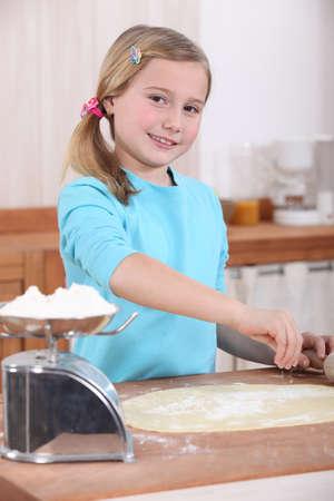 powdery: Girl making pizza dough Stock Photo