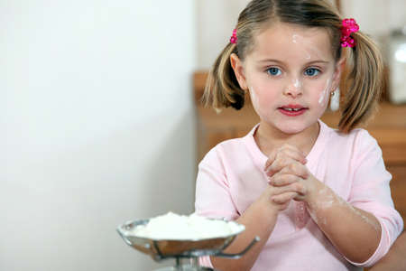 Girl stained with flour photo