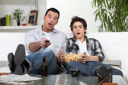 Father and son watching television photo
