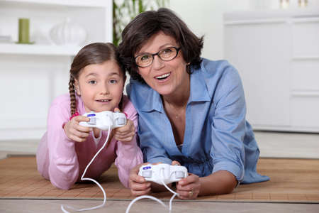 Mother and daughter playing video game photo