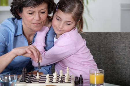 Grandmother playing chess photo