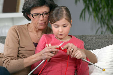 2 persons only: Little girl learning to knit