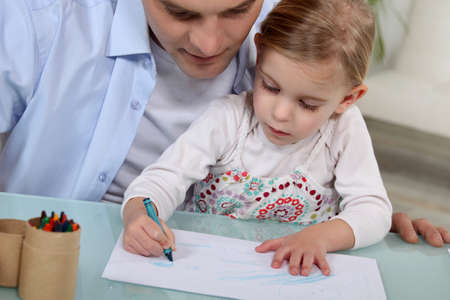 weekend activity: Father and daughter drawing Stock Photo