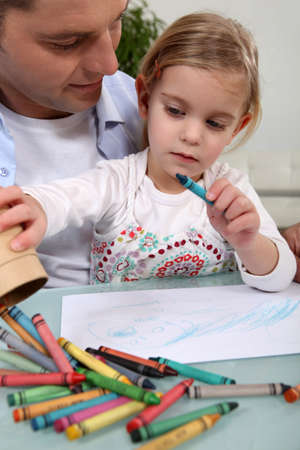working class: Man with little girl colouring