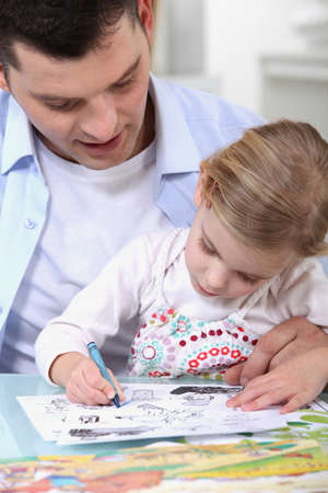 waxes: Father drawing with daughter