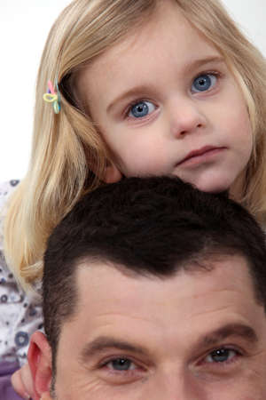 giving back: Father giving daughter piggy back