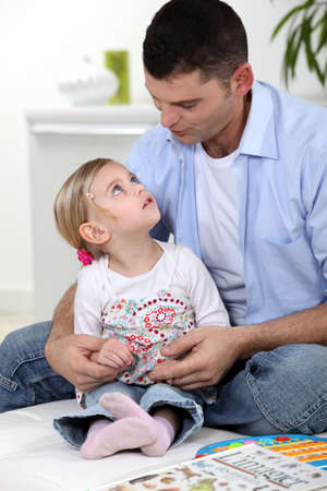 Father and daughter at home reading Stock Photo - 14214473