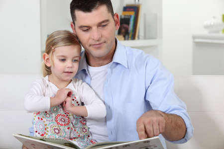 Father reading a story to his daughter photo