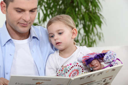 Father with daughter reading book photo