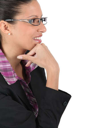 Woman observing away with eyeglasses photo