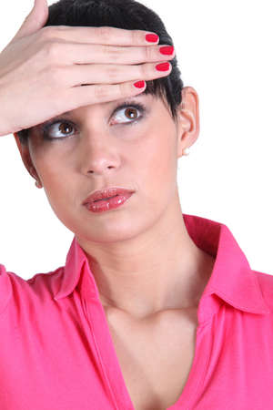 Young woman touching her forehead Stock Photo - 14214466