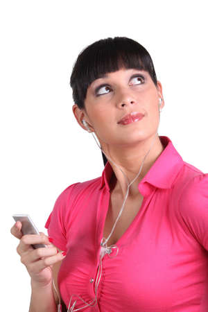 portable mp3 player: Woman with mp3 player Stock Photo