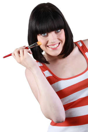 drollery: a brunette woman with a make-up pencil Stock Photo