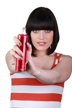 mugged: brunette with spray