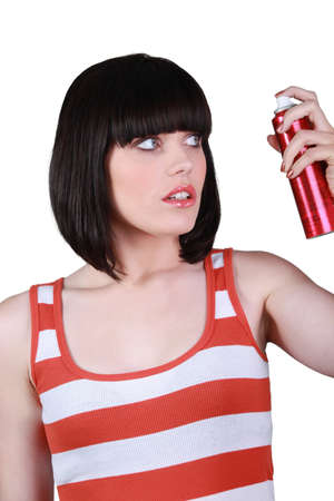 Sophisticated woman with hairspray photo