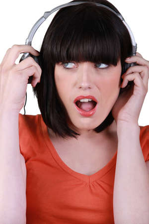 bombshell: Brunette wearing headphones Stock Photo