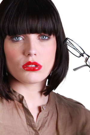 complaining: Brunette with glasses desolate Stock Photo
