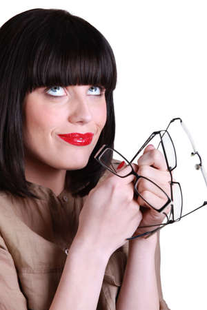 Woman with many pairs of glasses Stock Photo - 14211330