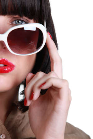 Posing woman with sunglasses photo