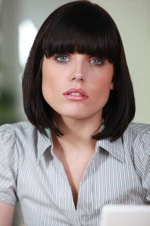 Female office worker with a bobbed haircut photo