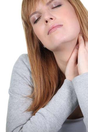 shut: Young woman relaxing with eyes shut